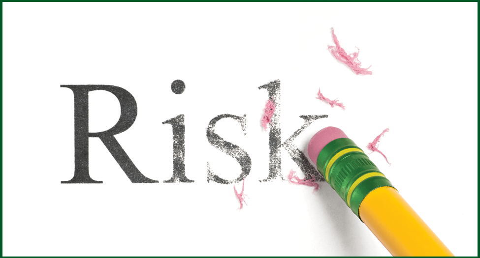 pencil erasing the word risk for illustration of risk mitigation